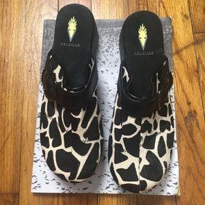 Volatile leather calf hair clogs